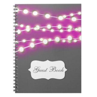 La secuencia enciende resplandor rosado libro de apuntes con espiral