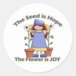 La semilla es flor de la esperanza es alegría etiqueta