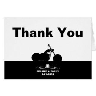 La silueta blanca negra del motorista de la tarjeta pequeña