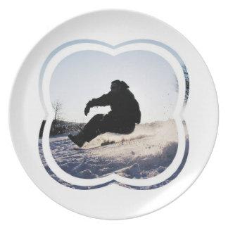La snowboard representa la placa plato de cena