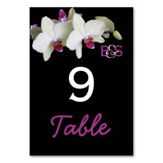 La tabla del boda de la orquídea numera tarjetas
