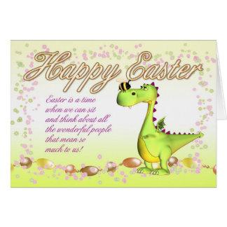 La tarjeta de pascua - pequeño dragón lindo y mano