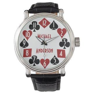 La tarjeta del jugador del casino del póker se reloj de mano