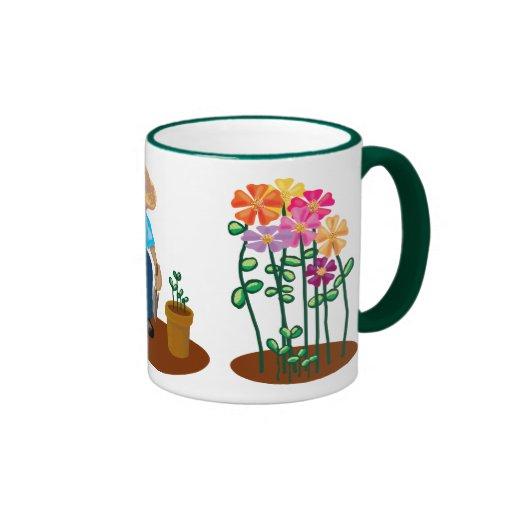 La taza del jardinero del jardín de flores