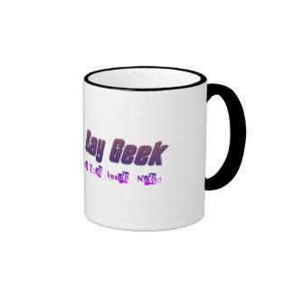 La taza gay del logotipo del friki