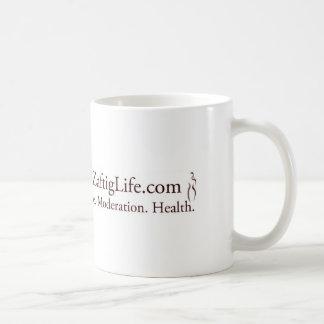 La taza regordeta y mona de la vida