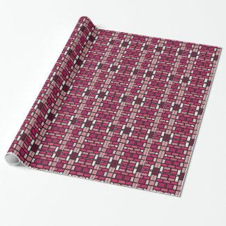 La teja rosada y negra ajusta el papel de papel de regalo