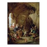 La tentación de St Anthony en una caverna rocosa Postal