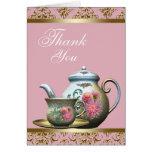 La tetera del rosa y del oro y la taza de té le ag tarjeta