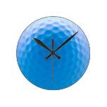 La textura de la pelota de golf forma hoyuelos el  relojes de pared