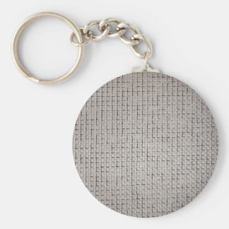 La textura de la tela gris llavero redondo tipo pin
