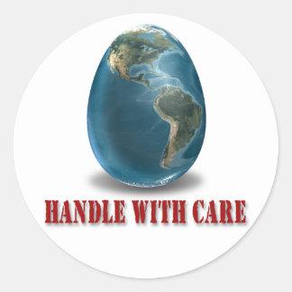 La tierra dirige con el pegatina del cuidado