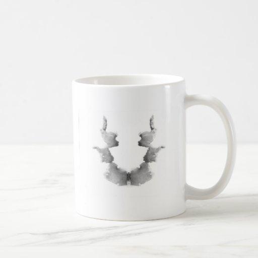 La tinta de la prueba de Rorschach borra caras de  Taza Básica Blanca