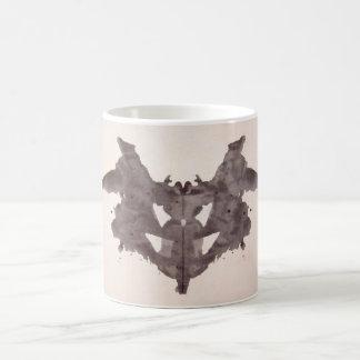 La tinta de la prueba de Rorschach borra el palo d Tazas De Café
