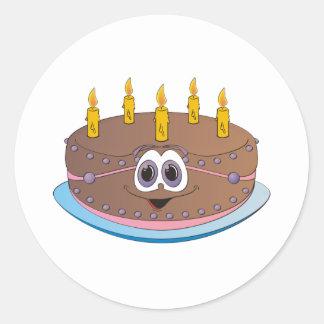 La torta de cumpleaños con oro mira al trasluz el pegatina redonda