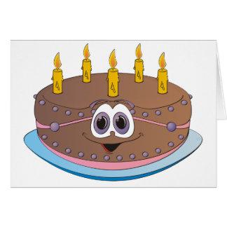 La torta de cumpleaños con oro mira al trasluz el  tarjeta de felicitación