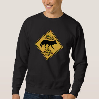 La travesía del coyote, trafica la señal de sudaderas encapuchadas