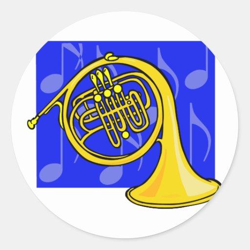 La trompa, amarillo, con las notas azules apoya pegatina redonda