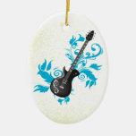 La turquesa de la guitarra eléctrica sale del orna ornamentos de reyes magos