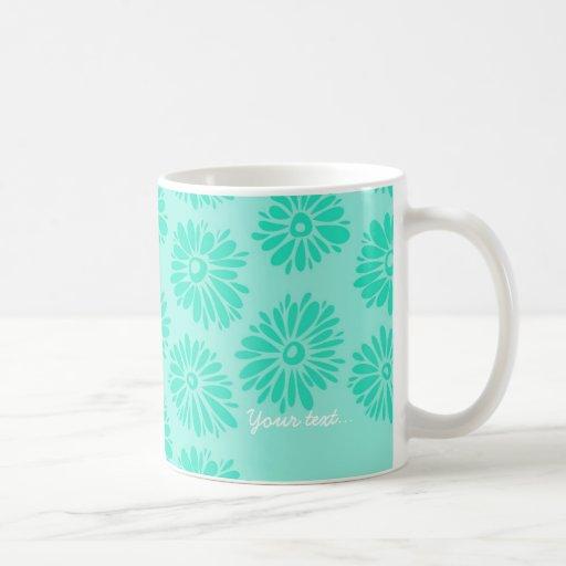 La turquesa florece la taza verde