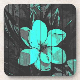 La turquesa fluorescente florece la madera posavasos