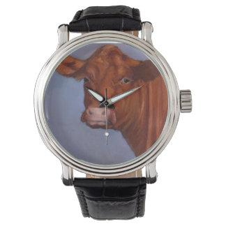 La vaca de ganado roja, engrasa el pastel, arte a relojes