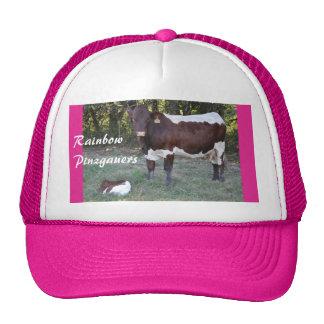 La vaca de Pinzgauer y el casquillo de las mujeres Gorros