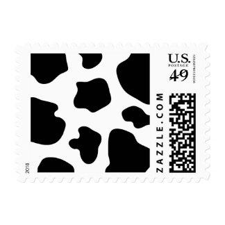 La vaca mancha el estampado de animales de la timbre postal