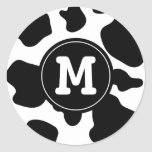 La vaca mancha el estampado de animales redondo etiqueta redonda