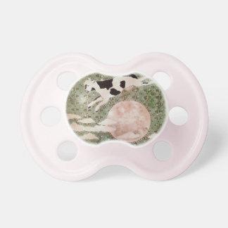 La vaca saltada sobre el pacificador de la luna chupete de bebe