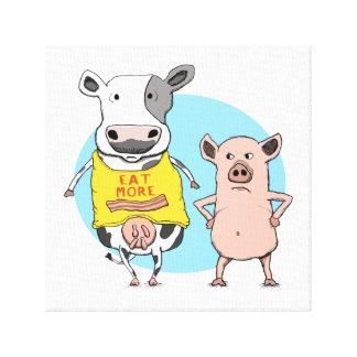 La vaca y el cerdo divertidos envolvieron la impresión en lienzo estirada