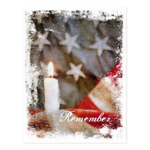 La vela conmemorativa con la bandera recuerda la p postales