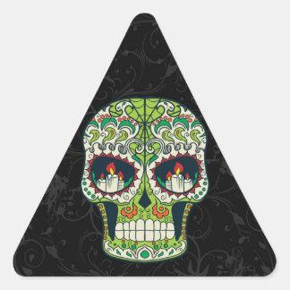 La vela observa el cráneo mexicano del azúcar del pegatina triangular