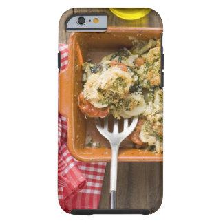 La verdura cuece con las patatas, tomates, puerros funda de iPhone 6 tough