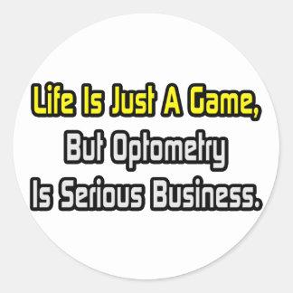 La vida es apenas un juego. La optometría es seria Etiquetas Redondas