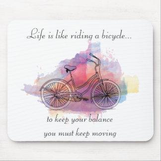 La vida es como montar una bicicleta tapete de ratones
