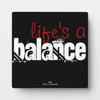 la vida es una placa de yang del yin de la balanza