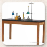 Lab table with chemicals coasters