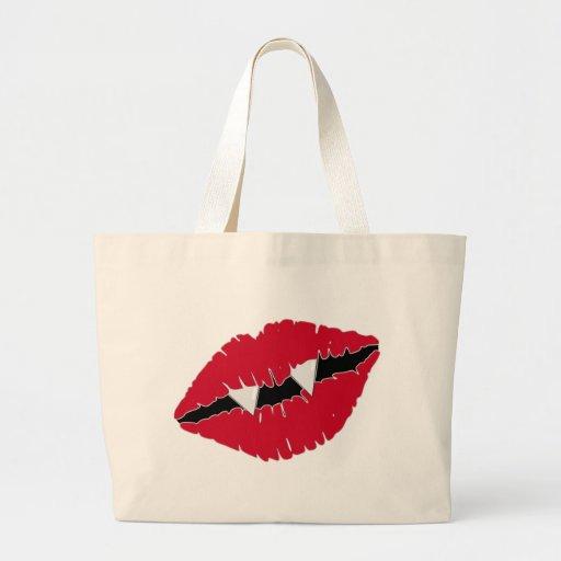 Labios y colmillos rojos bolsas