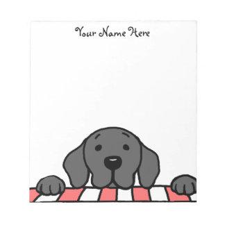 Labrador negro que le mira cocina bloc de notas