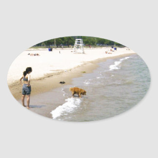 Labrador Playing in the Water Oval Sticker