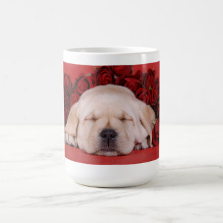 Labrador puppy sleeping in red roses coffee mug