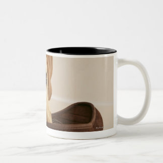 Labrador retriever puppy with slipper in his Two-Tone coffee mug