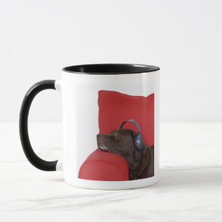 Labrador wearing headphones lying on sofa mug