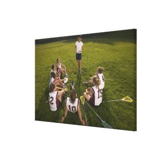 Lacrosse coach speaking to teenage (16-17) team canvas print