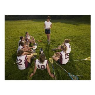 Lacrosse coach speaking to teenage (16-17) team postcard