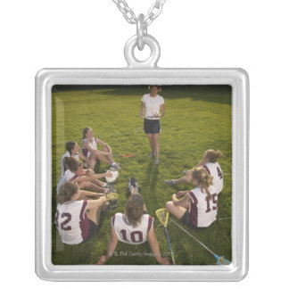 Lacrosse coach speaking to teenage (16-17) team silver plated necklace
