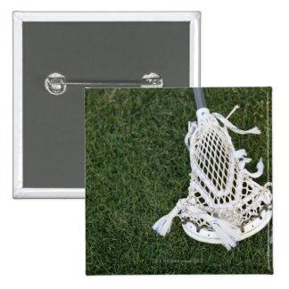 Lacrosse stick on grass pin