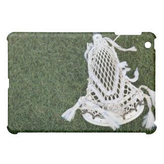 Lacrosse stick on grass iPad mini case