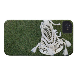 Lacrosse stick on grass iPhone 4 cover